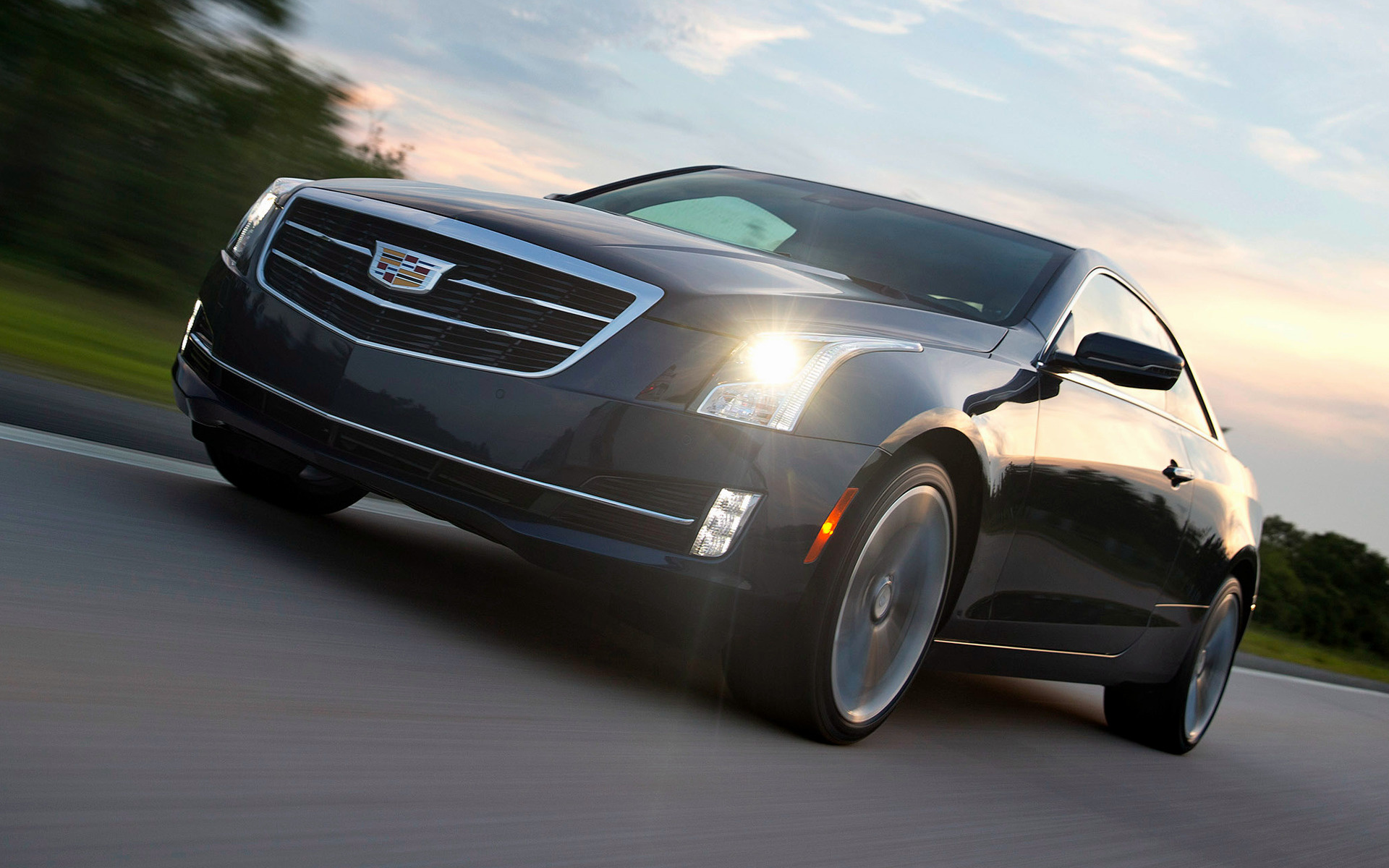 three ats look to cadillac advertisement quarter motor trend news first front en coupe skip