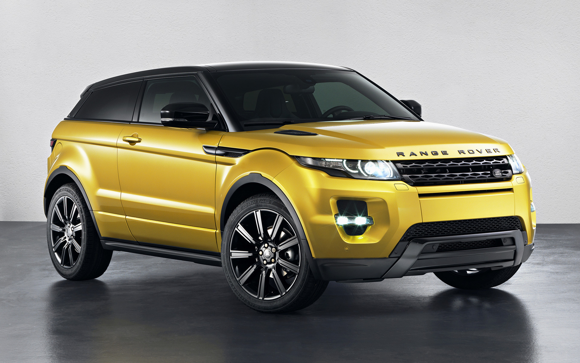 range rover evoque coupe sicilian yellow 2013 wallpapers and hd images car pixel. Black Bedroom Furniture Sets. Home Design Ideas