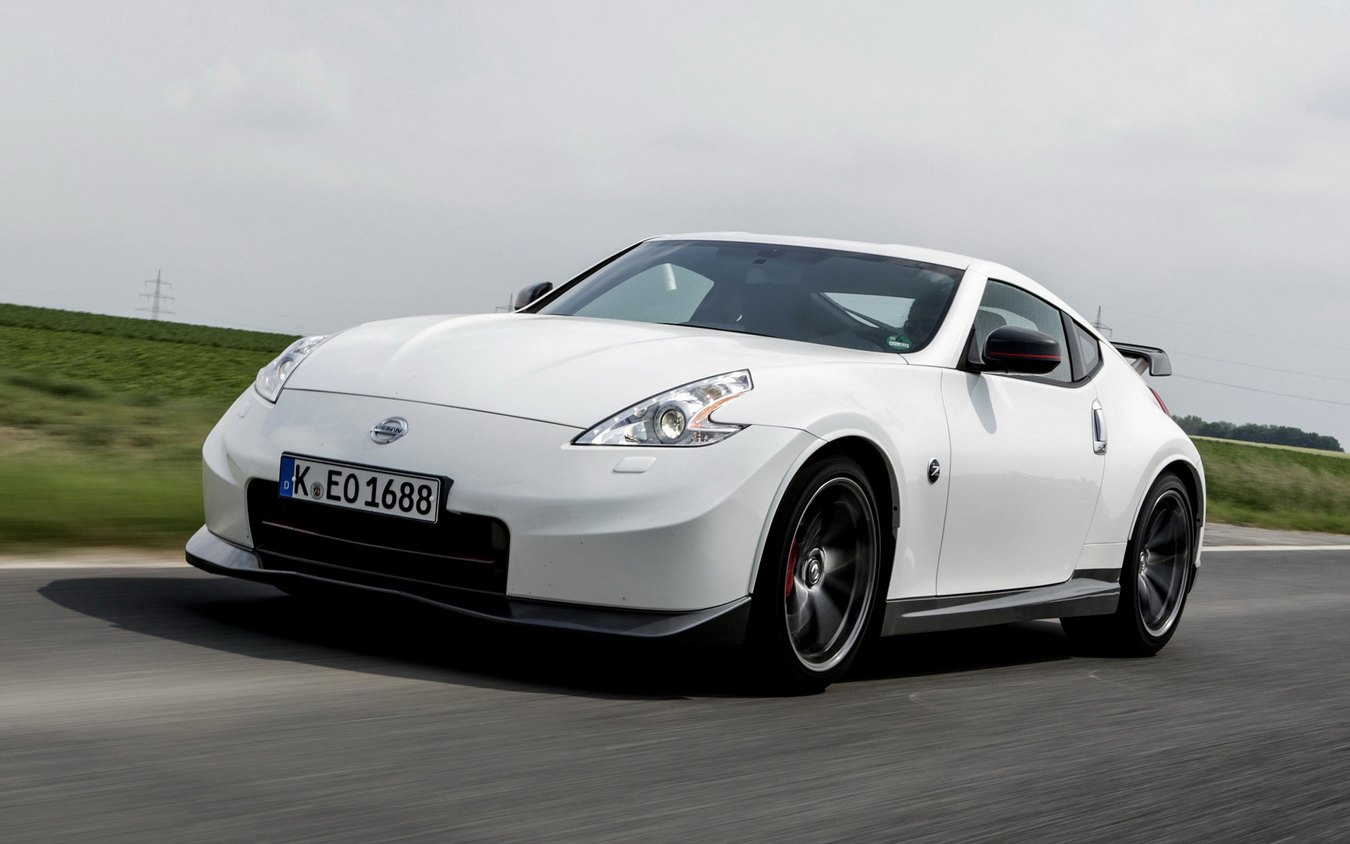Nissan 370z nismo 2013 wallpapers and hd images car pixel wide 85 nissan 370z nismo 2013 vanachro Choice Image